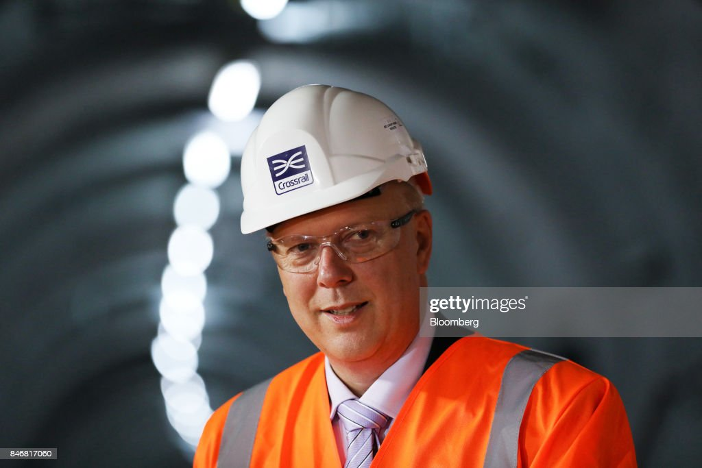 Chris Grayling, U.K. transport secretary, poses for a photograph during an event in a tunnel near Whitechapel station to celebrate the completion of the permanent Crossrail Ltd. track on the Elizabeth line in London, U.K., on Thursday, Sept. 14, 2017. Crossrail, which will be known as the Elizabeth Line once its up and running, hasnt yet set fares, but transit agency Transport for London has indicated they will be significantly less than Heathrow Express with a charging structure more akin to the Tube. Photographer: Chris Ratcliffe/Bloomberg via Getty Images