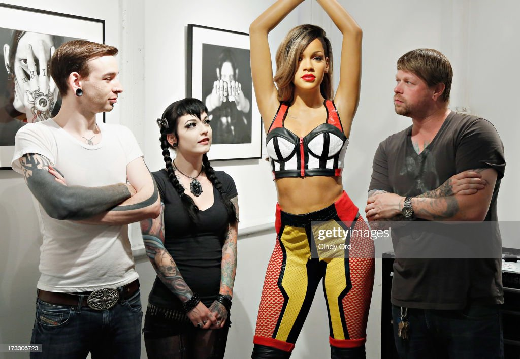 Chris Grearson, Jessica V. and Kevin Wilson of Sacred Tattoo pose with never before seen Madame Tussauds New York wax figure of singer <a gi-track='captionPersonalityLinkClicked' href=/galleries/search?phrase=Rihanna&family=editorial&specificpeople=453439 ng-click='$event.stopPropagation()'>Rihanna</a> (C) as it is unveiled at famed SOHO tattoo parlor Sacred Tattoo on on July 11, 2013 in New York City.