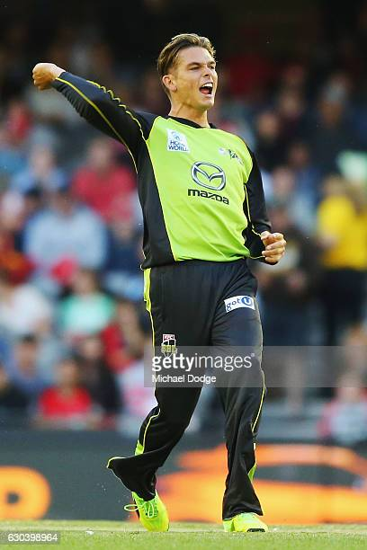 Chris Green of the Thunder celebrates the wicket of Cameron White of the Renegades during the Big Bash League match between the Melbourne Renegades...