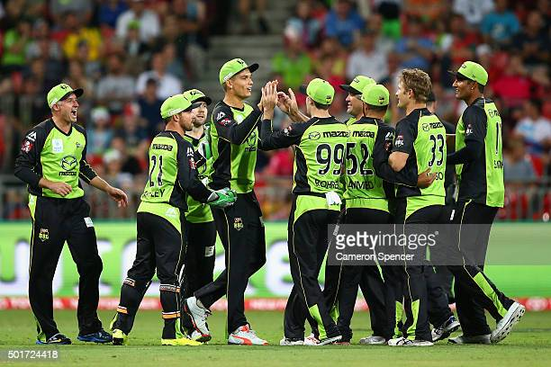 Chris Green of the Thunder celebrates with team mates after catching out Jordan Silk of the Sixers off the delivery of team mate Shane Watson during...