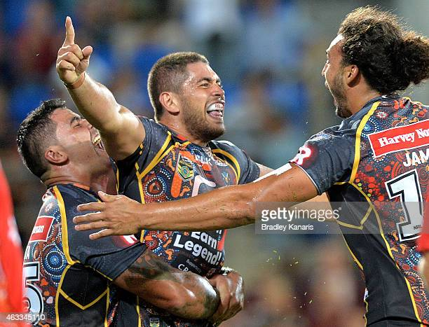 Chris Grevsmuhl of the Indigenous All Stars celebrates with team mates after scoring a try during the NRL preseason match between the Indigenous All...