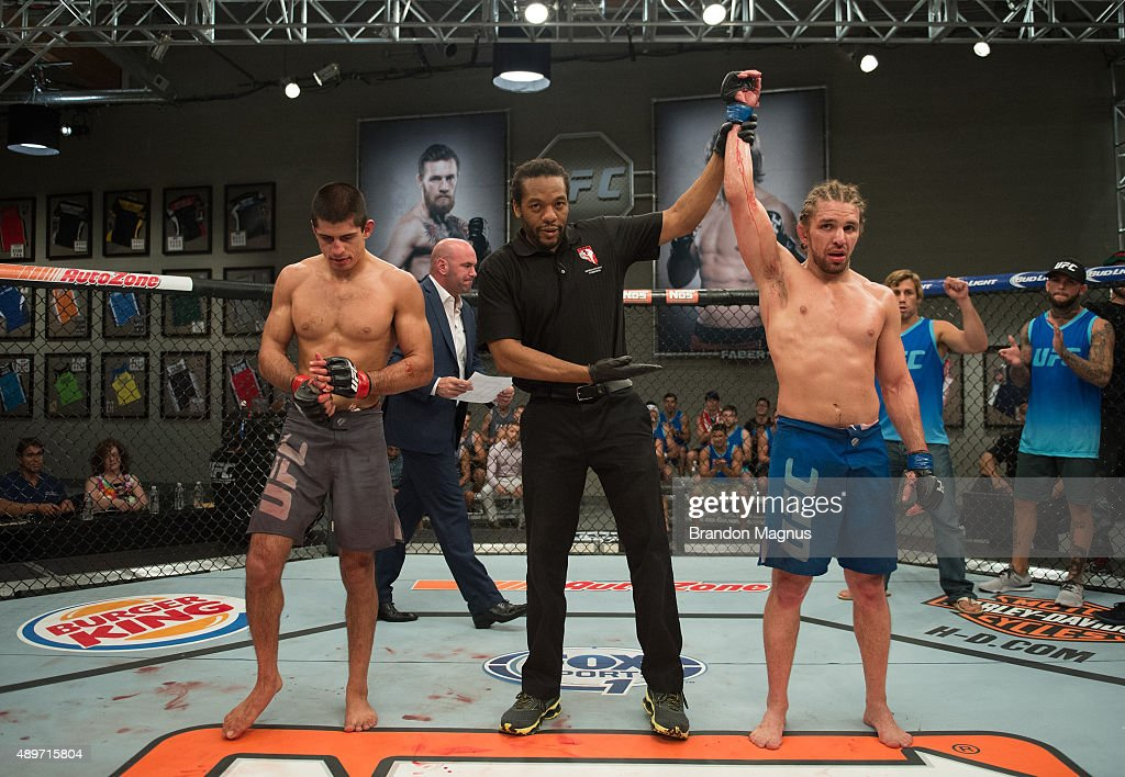 Chris Gruetzemacher celebrates his victory over Sascha Sharma up ahgainst the cage during the filming of The Ultimate Fighter Team McGregor vs Team...