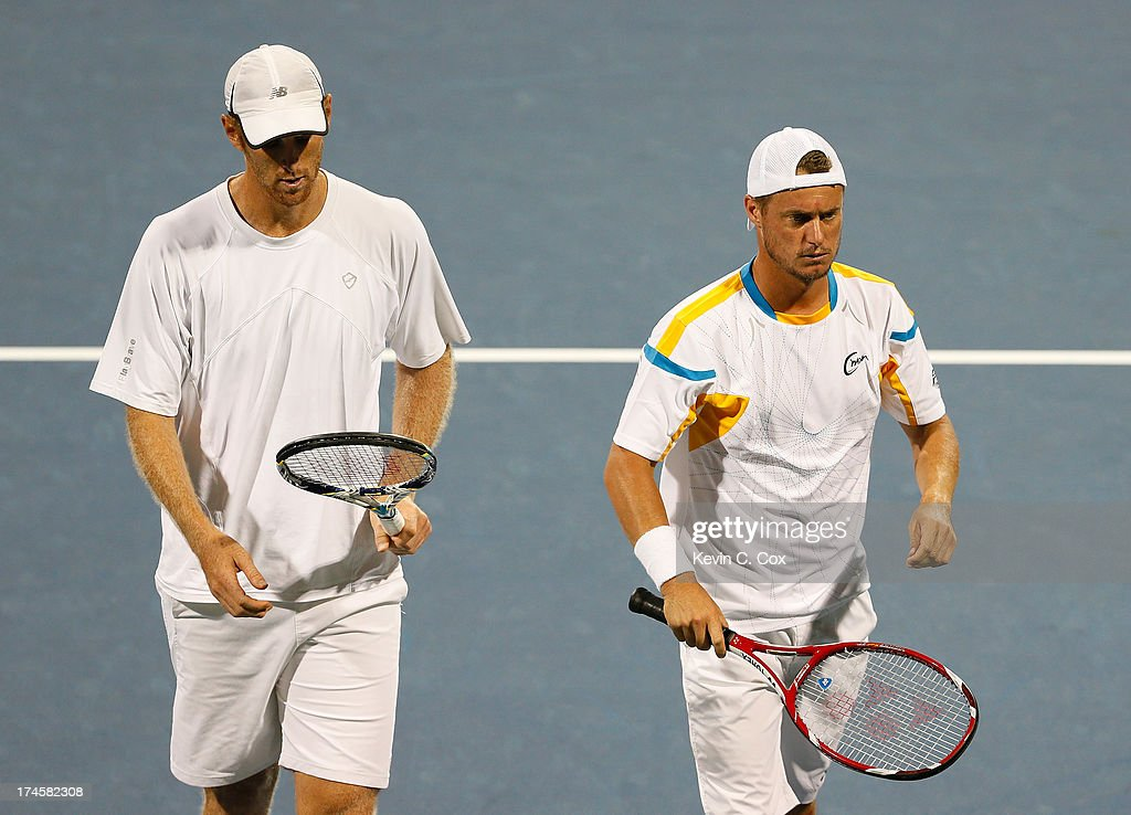 Chris Guccione and <a gi-track='captionPersonalityLinkClicked' href=/galleries/search?phrase=Lleyton+Hewitt&family=editorial&specificpeople=167178 ng-click='$event.stopPropagation()'>Lleyton Hewitt</a>, both of Australia, react after a point against Colin Fleming and Jonathan Marray, both of Great Britain, during the BB&T Atlanta Open in Atlantic Station on July 27, 2013 in Atlanta, Georgia.