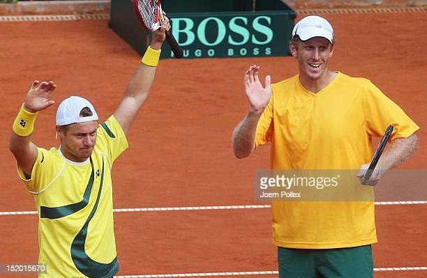 Chris Guccione and Lleyton Hewitt of Australia celebrate after winning their doubles match against Benjamin Becker and Philipp Petzschner of Germany...