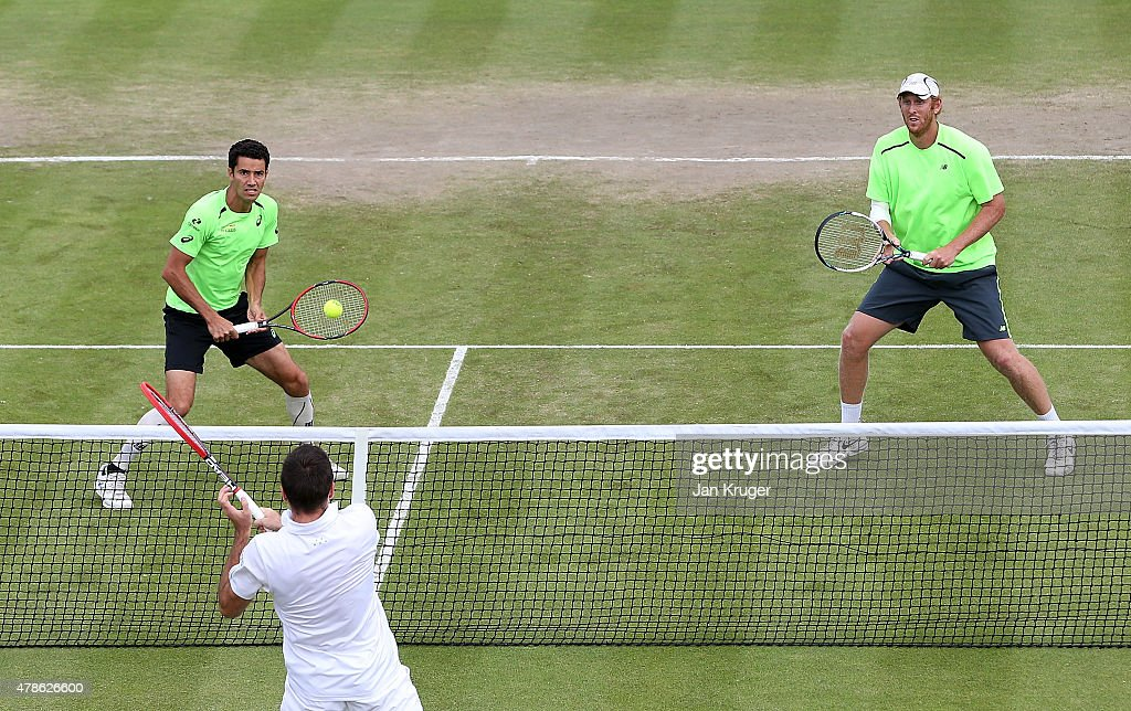 Chris Guccione of Australia(R) and Andre Sa of Brazil in action against Colin Fleming of Great Britain and doubles partner Eric Butorac of USA during their semi final match on day six of the Aegon Open Nottingham at Nottingham Tennis Centre on June 26, 2015 in Nottingham, England.
