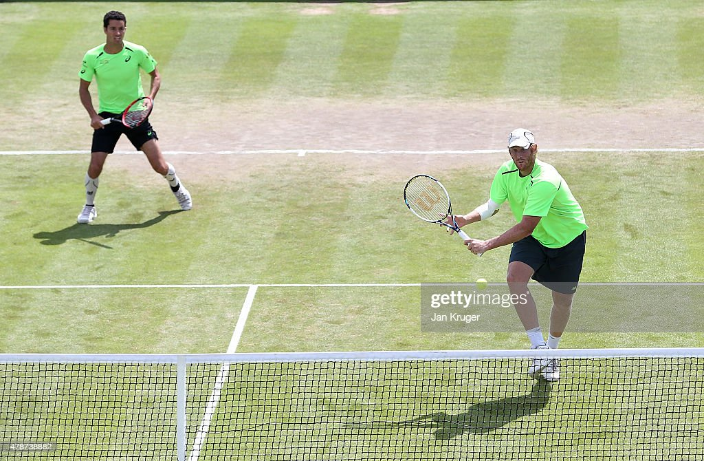 Chris Guccione of Australia and Andre Sa of Brazil in action against Pablo Cuevas of Uruguay and David Marrero of Spain in their mens doubles final match on day seven of the Aegon Open Nottingham at Nottingham Tennis Centre on June 27, 2015 in Nottingham, England.