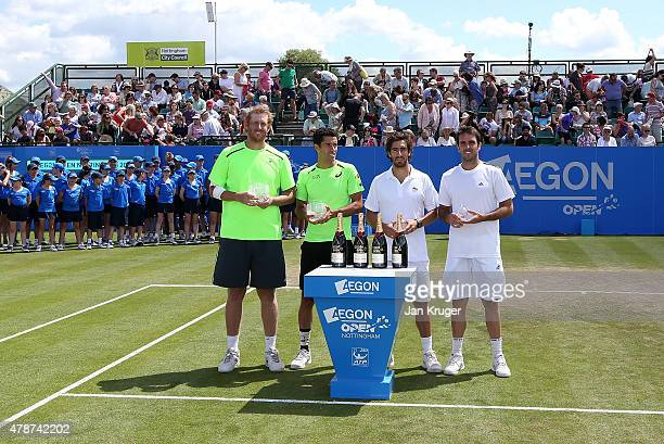 Chris Guccione of Australia and Andre Sa of Brazil pose with runners up Pablo Cuevas of Uruguay and David Marrero of Spain after their mens doubles...