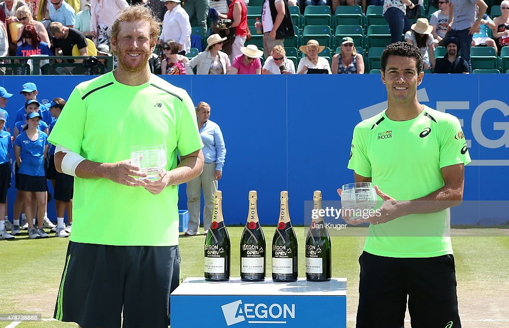 Chris Guccione of Australia(L) and Andre Sa of Brazil pose with their trophys after beating Pablo Cuevas of Uruguay and David Marrero of Spain during the mens doubles final match on day seven of the Aegon Open Nottingham at Nottingham Tennis Centre on June 27, 2015 in Nottingham, England.