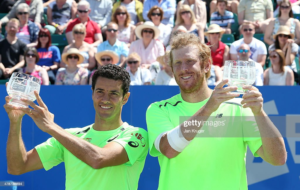 Chris Guccione of Australia(R) and Andre Sa of Brazil pose with their trophys after beating Pablo Cuevas of Uruguay and David Marrero of Spain during the mens doubles final match on day seven of the Aegon Open Nottingham at Nottingham Tennis Centre on June 27, 2015 in Nottingham, England.