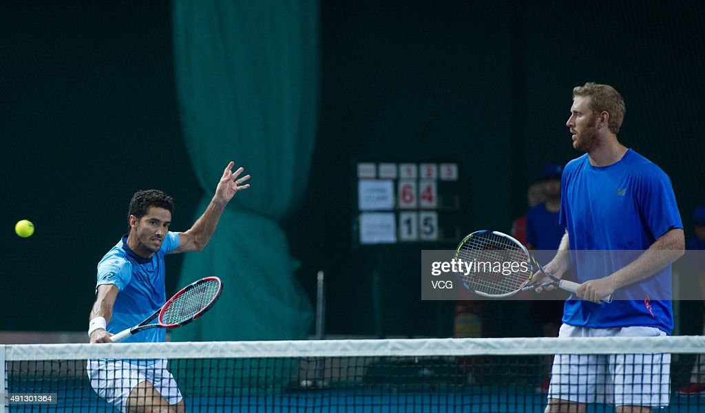 <a gi-track='captionPersonalityLinkClicked' href=/galleries/search?phrase=Chris+Guccione+-+Tennis+Player&family=editorial&specificpeople=217596 ng-click='$event.stopPropagation()'>Chris Guccione</a> (R) of Australia and <a gi-track='captionPersonalityLinkClicked' href=/galleries/search?phrase=Andre+Sa&family=editorial&specificpeople=695817 ng-click='$event.stopPropagation()'>Andre Sa</a> of Brazil return a shot against Colin Fleming of Britain and Jonathan Erlich of Israelduring the men's doubles final at the Shenzhen Open tennis tournament on October 4, 2015 in Shenzhen, China.