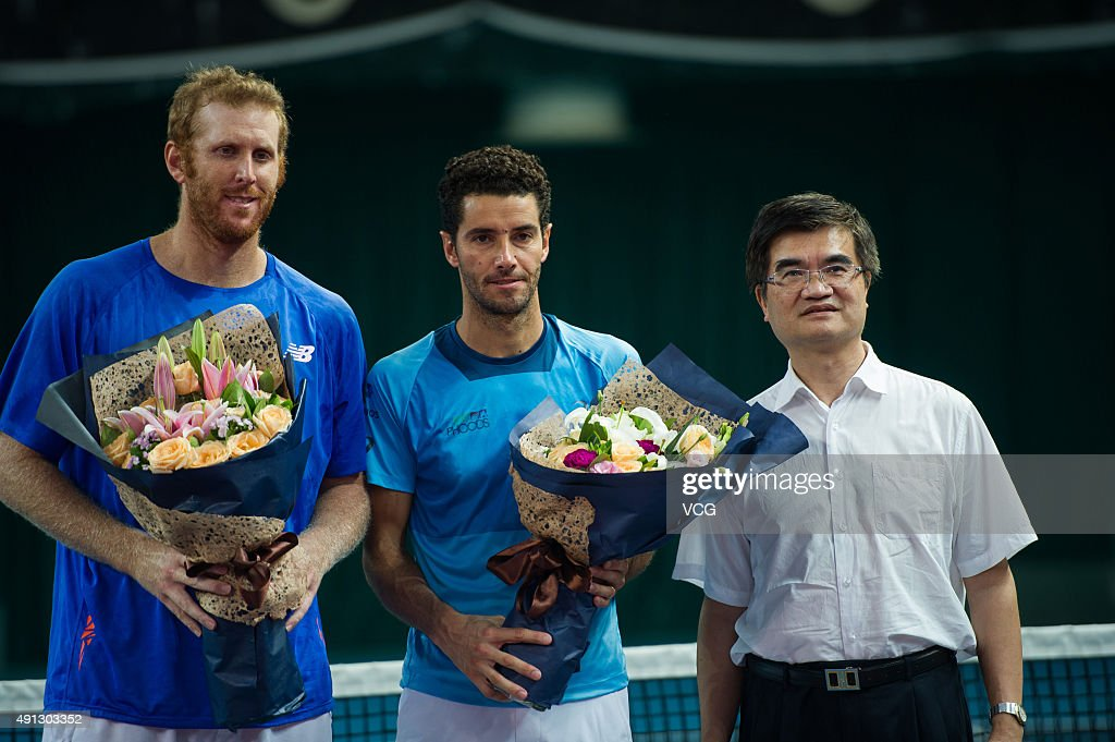 Chris Guccione (L1) of Australia and Andre Sa (C) of Brazil stand on the podium after the men's doubles final at the Shenzhen Open tennis tournament on October 4, 2015 in Shenzhen, China.