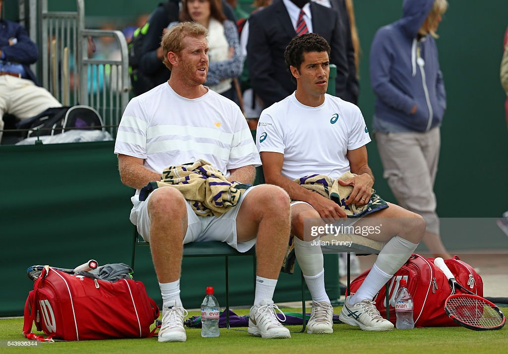 <a gi-track='captionPersonalityLinkClicked' href=/galleries/search?phrase=Chris+Guccione+-+Tennis+Player&family=editorial&specificpeople=217596 ng-click='$event.stopPropagation()'>Chris Guccione</a> of Australia and <a gi-track='captionPersonalityLinkClicked' href=/galleries/search?phrase=Andre+Sa&family=editorial&specificpeople=695817 ng-click='$event.stopPropagation()'>Andre Sa</a> of Brazil talk tactics during the Men's doubles first round match against Mate Pavic of Croatia and Michael Venus of New Zealand on day four of the Wimbledon Lawn Tennis Championships at the All England Lawn Tennis and Croquet Club on June 30, 2016 in London, England.