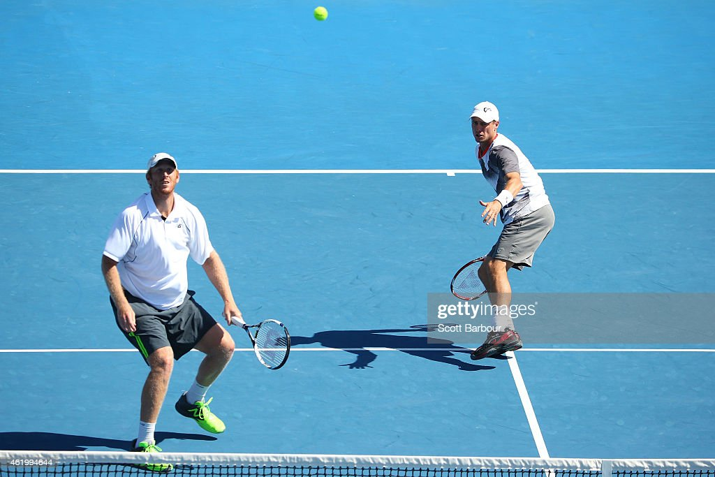 <a gi-track='captionPersonalityLinkClicked' href=/galleries/search?phrase=Chris+Guccione+-+Tennis+Player&family=editorial&specificpeople=217596 ng-click='$event.stopPropagation()'>Chris Guccione</a> of Australia and <a gi-track='captionPersonalityLinkClicked' href=/galleries/search?phrase=Lleyton+Hewitt&family=editorial&specificpeople=167178 ng-click='$event.stopPropagation()'>Lleyton Hewitt</a> of Australia in action in their second round doubles match against Jean-Julien Rojer of the Netherlands and Horia Tecau of Romania during day five of the 2015 Australian Open at Melbourne Park on January 23, 2015 in Melbourne, Australia.