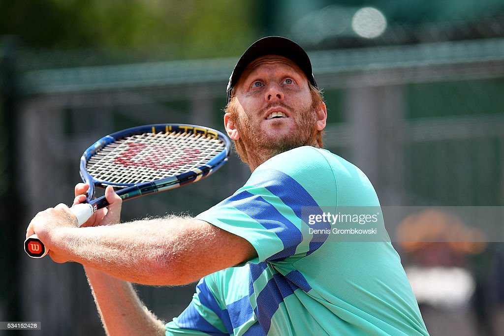 <a gi-track='captionPersonalityLinkClicked' href=/galleries/search?phrase=Chris+Guccione+-+Tennis+Player&family=editorial&specificpeople=217596 ng-click='$event.stopPropagation()'>Chris Guccione</a> of Australia plays a backhand during the Men's Doubles first round match against Juan Sebastian Cabal and Robert Farah of Columbia on day four of the 2016 French Open at Roland Garros on May 25, 2016 in Paris, France.