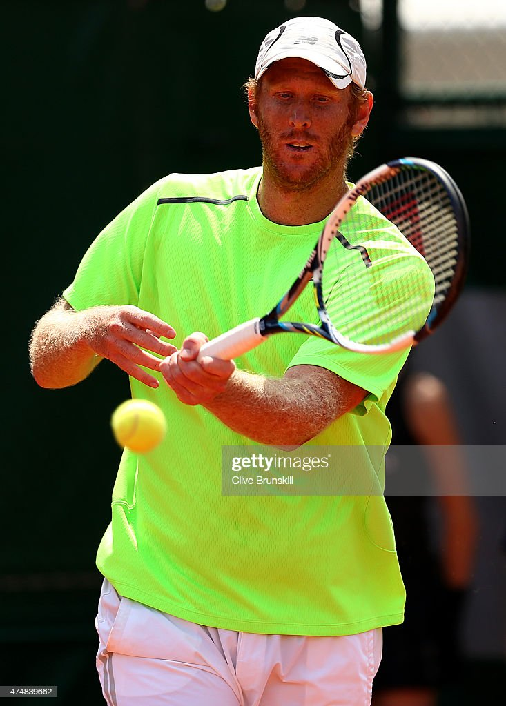 Chris Guccione of Australia returns a shot next to his partner James Duckworth of Australia during their men's doubles match against Daniel Nestor of Canada and Leander Paes of India during day four of the 2015 French Open at Roland Garros on May 27, 2015 in Paris, France.