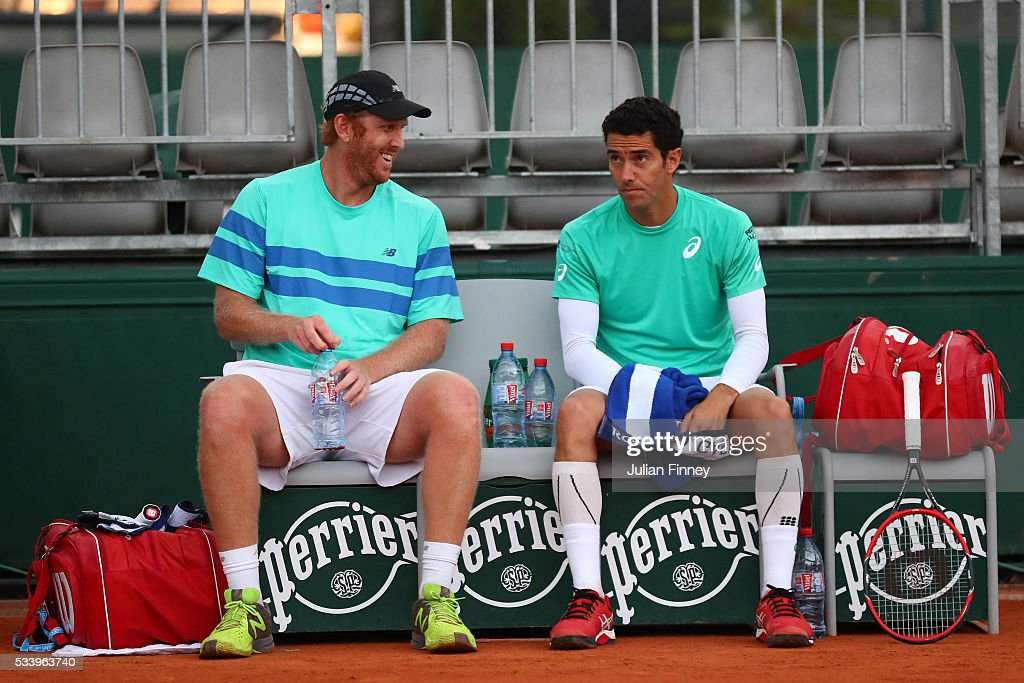 <a gi-track='captionPersonalityLinkClicked' href=/galleries/search?phrase=Chris+Guccione+-+Tennis+Player&family=editorial&specificpeople=217596 ng-click='$event.stopPropagation()'>Chris Guccione</a> of Australia (L) talks with <a gi-track='captionPersonalityLinkClicked' href=/galleries/search?phrase=Andre+Sa&family=editorial&specificpeople=695817 ng-click='$event.stopPropagation()'>Andre Sa</a> of Brazil during the Men's Doubles first round match against Juan Sebastian Cabal and Robert Farah Farah of Columbia on day three of the 2016 French Open at Roland Garros on May 24, 2016 in Paris, France.