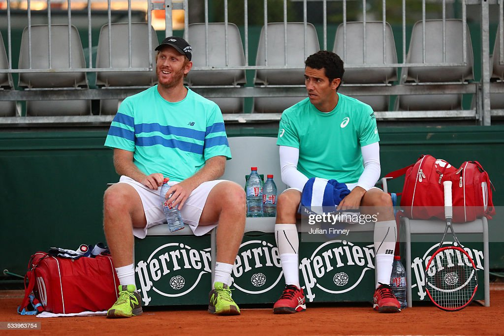 Chris Guccione of Australia (L) talks with Andre Sa of Brazil during the Men's Doubles first round match against Juan Sebastian Cabal and Robert Farah Farah of Columbia on day three of the 2016 French Open at Roland Garros on May 24, 2016 in Paris, France.