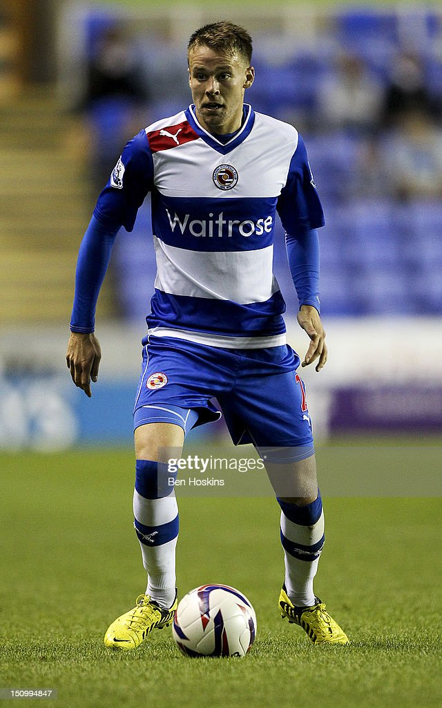 Chris Gunter of Reading in action during the Capital One Cup Second Round match between Reading and Peterborough United at The Madejski Stadium on August 28, 2012 in Reading, England.
