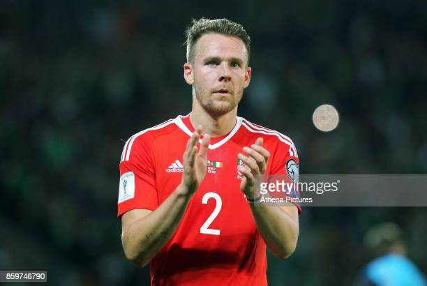 Chris Gunter of Wales applauds home supporters during the FIFA World Cup Qualifier Group D match between Wales and Republic of Ireland at The Cardiff...