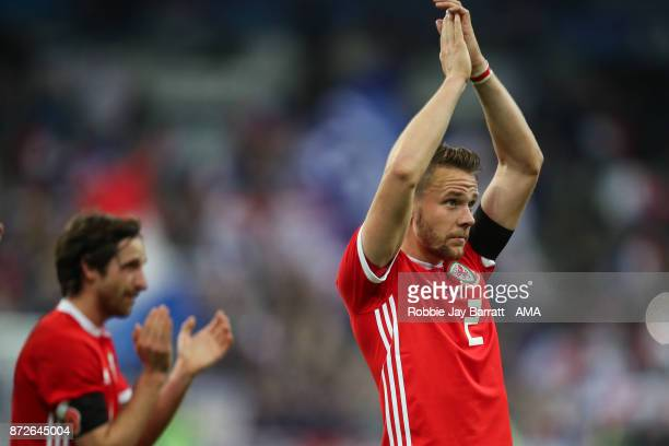 Chris Gunter of Wales applauds the fans at full time during the International Friendly fixture between France and Wales at Stade de France on...