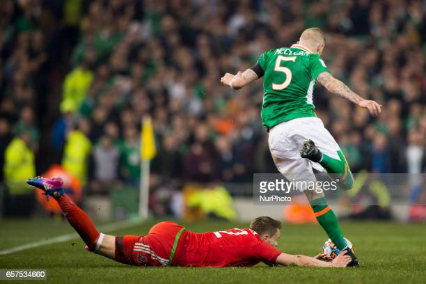 Chris Gunter of Wales fouled by James McClean of Ireland during the 2018 FIFA World Cup Qualifying Round Group D match between Republic of Ireland...