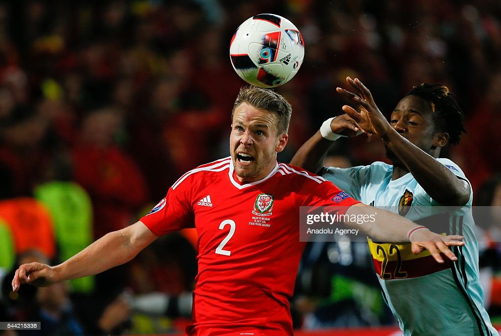 Chris Gunter (2) of Wales in action against Michy Batshuayi (22) of Belgium during the UEFA Euro 2016 quarter final match between Wales and Belgium at Stade Pierre-Mauroy on July 1, 2016 in Lille, France.