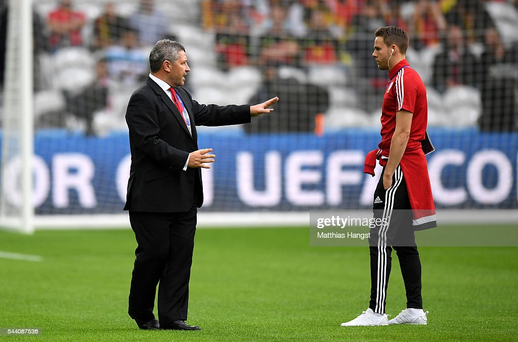 Chris Gunter (R) of Wales is seen during the pitch inspection prior to the UEFA EURO 2016 quarter final match between Wales and Belgium at Stade Pierre-Mauroy on July 1, 2016 in Lille, France.
