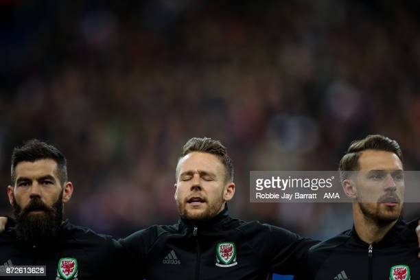 Chris Gunter of Wales signs the Wales national anthem prior to the International Friendly fixture between France and Wales at Stade de France on...