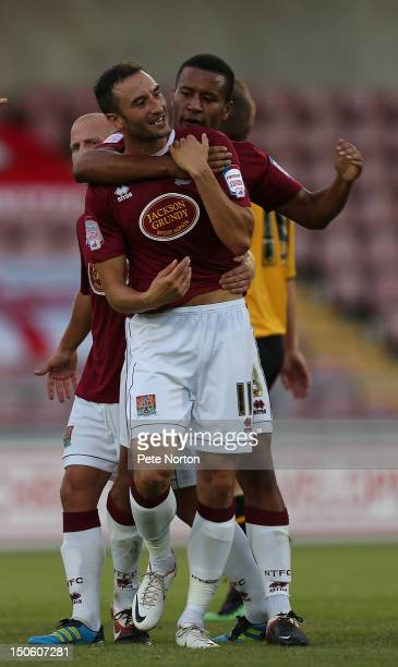 Chris Hackett of Northampton Town celebrates with team mate Joe Widdowson after scoring his sides 1st goal during the npower League Two match between...