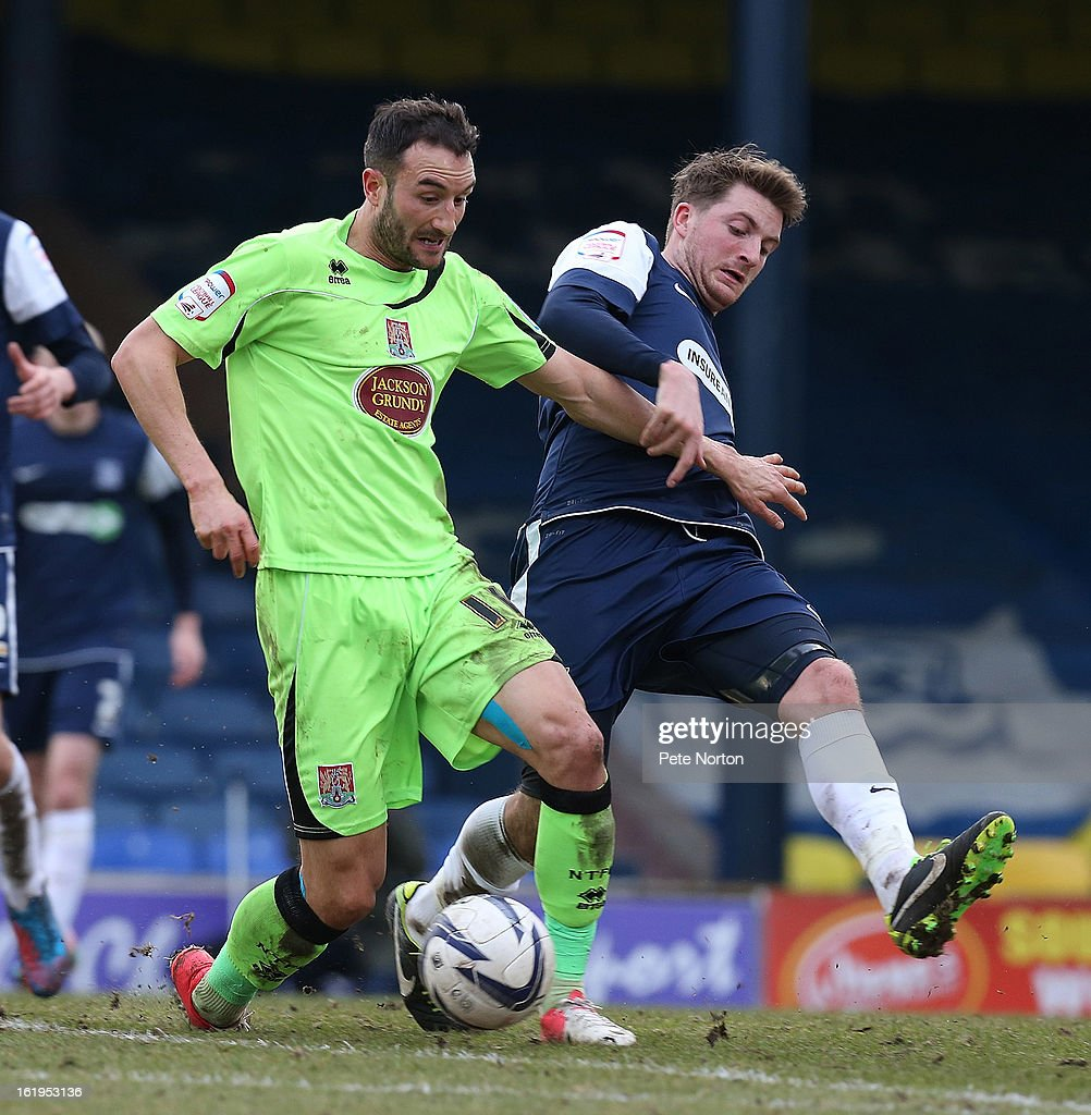 Chris Hackett of Northampton Town controls the ball under pressure from Michael Spillane of Southend United during the npower League Two match between Southend United and Northampton Town at Roots Hall on February 16, 2013 in Southend, England.
