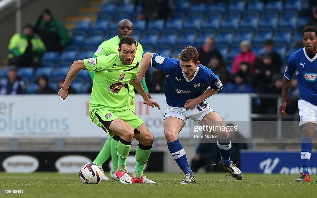 Chris Hackett of Northampton Town looks to control the ball under pressure from Craig Clay of Chesterfield during the npower League Two match between Chesterfield and Northampton Town at the Proact Srtadium on January 12, 2013 in Chesterfield, England.
