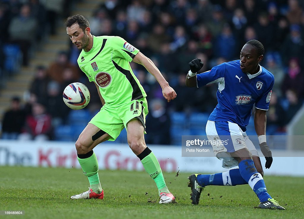 Chris Hackett of Northampton Town looks to control the ball watched by Nathan Smith of Chesterfield during the npower League Two match between Chesterfield and Northampton Town at the Proact Srtadium on January 12, 2013 in Chesterfield, England.