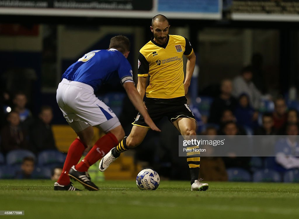 Chris Hackett of Northampton Town looks to play the ball watched by Ben Chorley of Portsmouth to head the ball during the Sky Bet League Two match between Portsmouth and Northampton Town at Fratton Park on August 19, 2014 in Portsmouth, England.