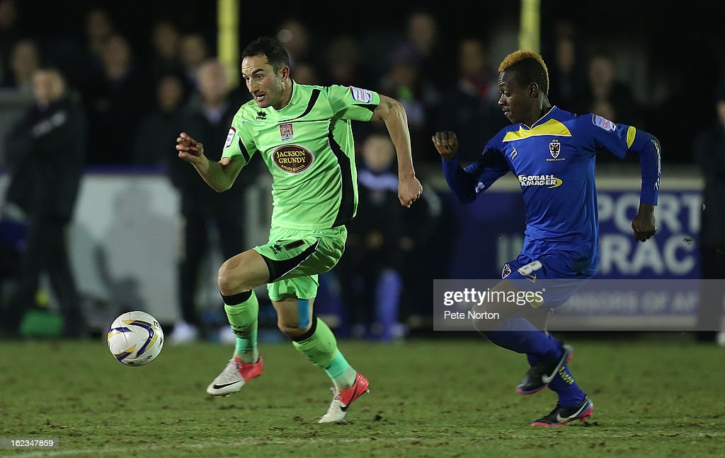 Chris Hackett of Northampton Town moves forward with the bal from Toby Ajala of AFC Wimbledon during the npower League Two match between AFC Wimbledon and Northampton Town at The Cherry Red Records Stadium on February 19, 2013 in Kingston upon Thames, England.