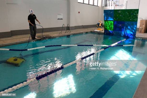 DENVER CO NOVEMBER 29 Chris Hale left with Denver Parks and Recreation works on cleaning the kids pool in the new Carla Madison Recreation Center on...