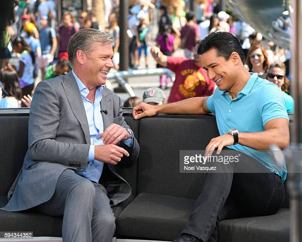 Chris Hansen and Mario Lopez visit 'Extra' at Universal Studios Hollywood on August 22 2016 in Universal City California