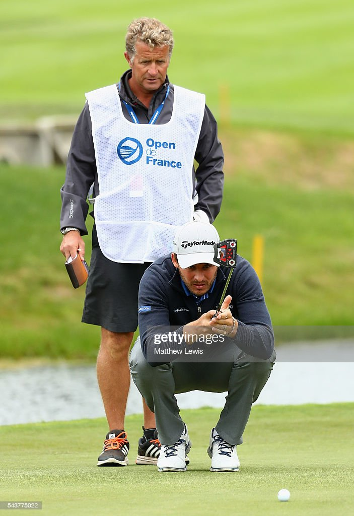 <a gi-track='captionPersonalityLinkClicked' href=/galleries/search?phrase=Chris+Hanson+-+Golfer&family=editorial&specificpeople=15203701 ng-click='$event.stopPropagation()'>Chris Hanson</a> of England lines up a putt with his caddie during day one of the 100th Open de France at Le Golf National on June 30, 2016 in Paris, France.