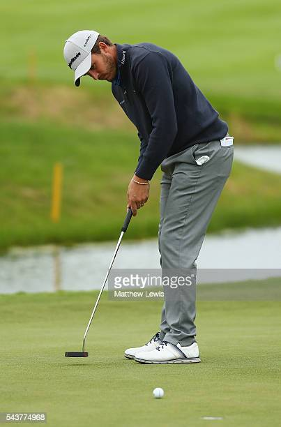 Chris Hanson of England makes a putt during day one of the 100th Open de France at Le Golf National on June 30 2016 in Paris France