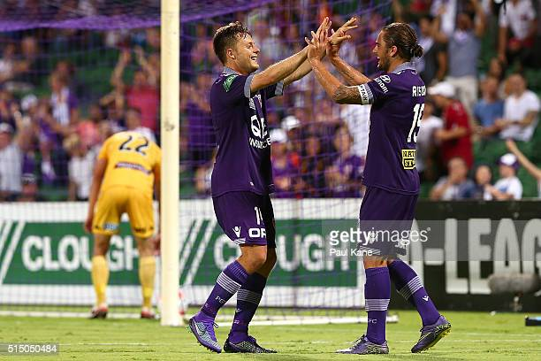 Chris Harold and Josh Risdon of the Glory celebrate after the fourth goal during the round 23 ALeague match between the Perth Glory and the Central...