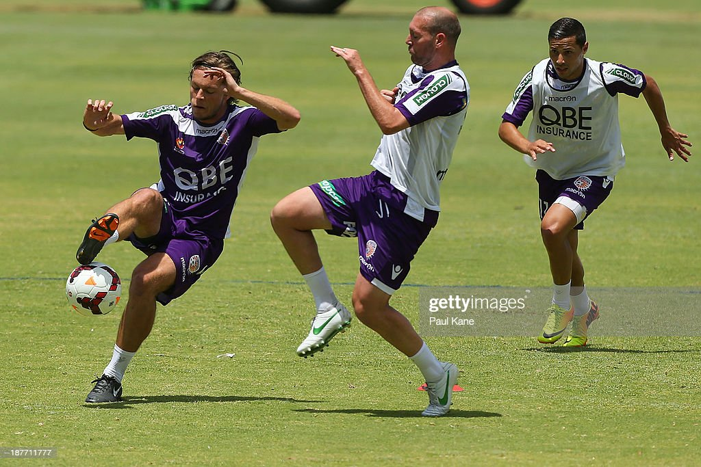 Chris Harold controls the ball against Steven McGarry during a Perth Glory A-League training session at McGillivray Oval on November 12, 2013 in Perth, Australia.