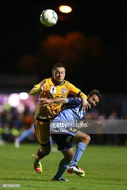Chris Harold of the Glory and Michael Zullo of Sydney contest for the ball during the round 16 FFA Cup match between Perth Glory and Sydney FC at...