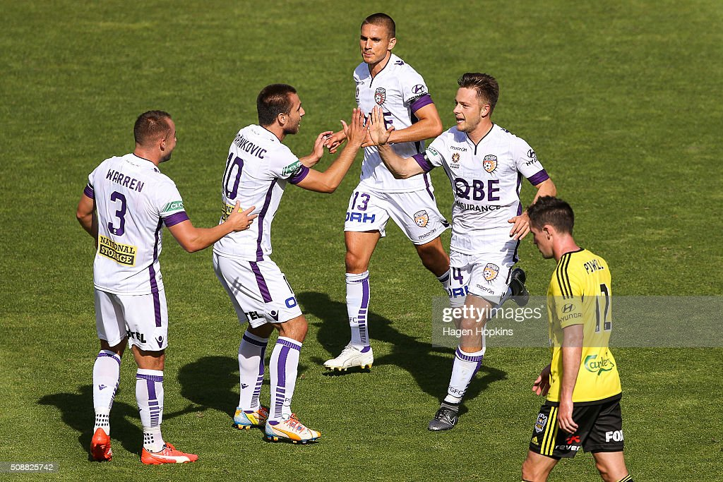 Chris Harold of the Glory celebrates his goal with teammate Nebojsa Marinkovic during the round 18 A-League match between Wellington Phoenix and Perth Glory at Westpac Stadium on February 7, 2016 in Wellington, New Zealand.