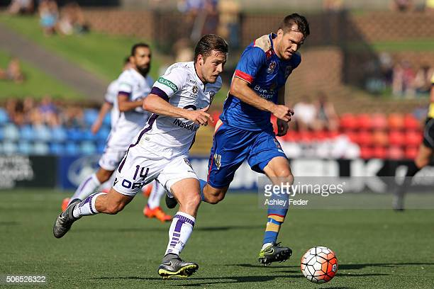 Chris Harold of the Glory contests the ball against Nigel Boogaard of the Jets during the round 16 ALeague match between the Newcastle Jets and the...