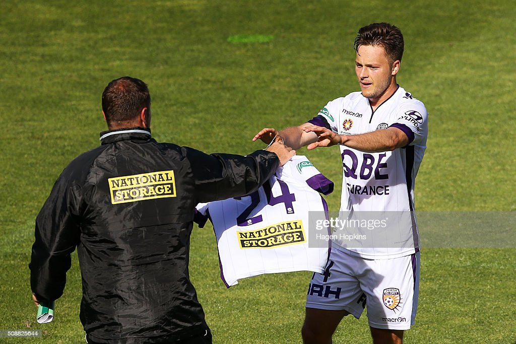 Chris Harold of the Glory is handed the shirt of teammate Jamal Reiners while celebrating his goal during the round 18 A-League match between Wellington Phoenix and Perth Glory at Westpac Stadium on February 7, 2016 in Wellington, New Zealand.