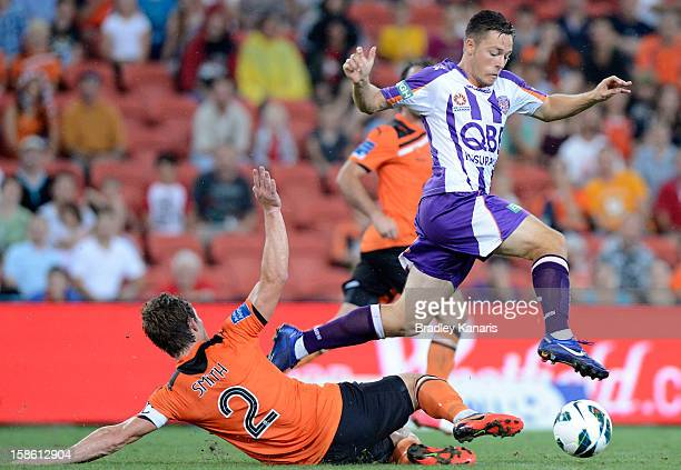 Chris Harold of the Glory is tackled by Matthew Smith of the Roar during the round 12 ALeague match between the Brisbane Roar and the Perth Glory at...