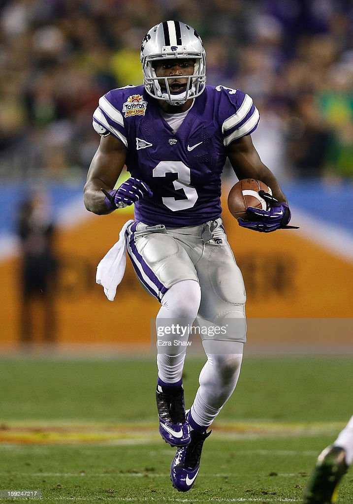 Chris Harper #3 of the Kansas State Wildcats carries the ball against the Oregon Ducks during the Tostitos Fiesta Bowl at University of Phoenix Stadium on January 3, 2013 in Glendale, Arizona.