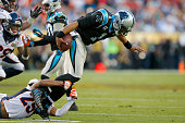 Chris Harris Jr #25 of the Denver Broncos attempts to tackle Cam Newton of the Carolina Panthers during the second quarter of Super Bowl 50 at Levi's...