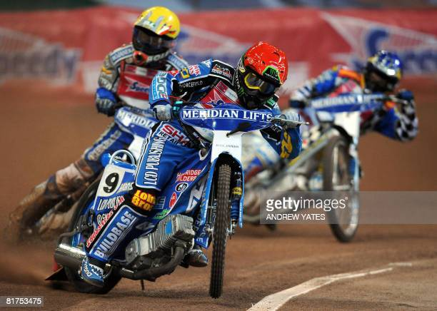 Chris Harris of Great Britain leads from Tomasz Gollob of Poland and Rune Holta of Poland during the British Speedway Grand Prix at the Millennium...