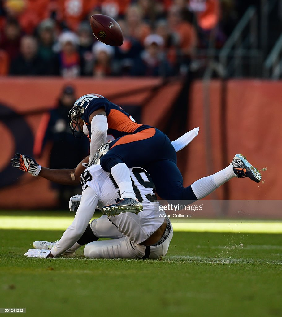 Chris Harris (25) of the Denver Broncos breaks up a pass intended for Amari Cooper (89) of the Oakland Raiders in the second quarter. The Broncos played the Oakland Raiders at Sports Authority Field at Mile High in Denver, CO on December 13, 2015.