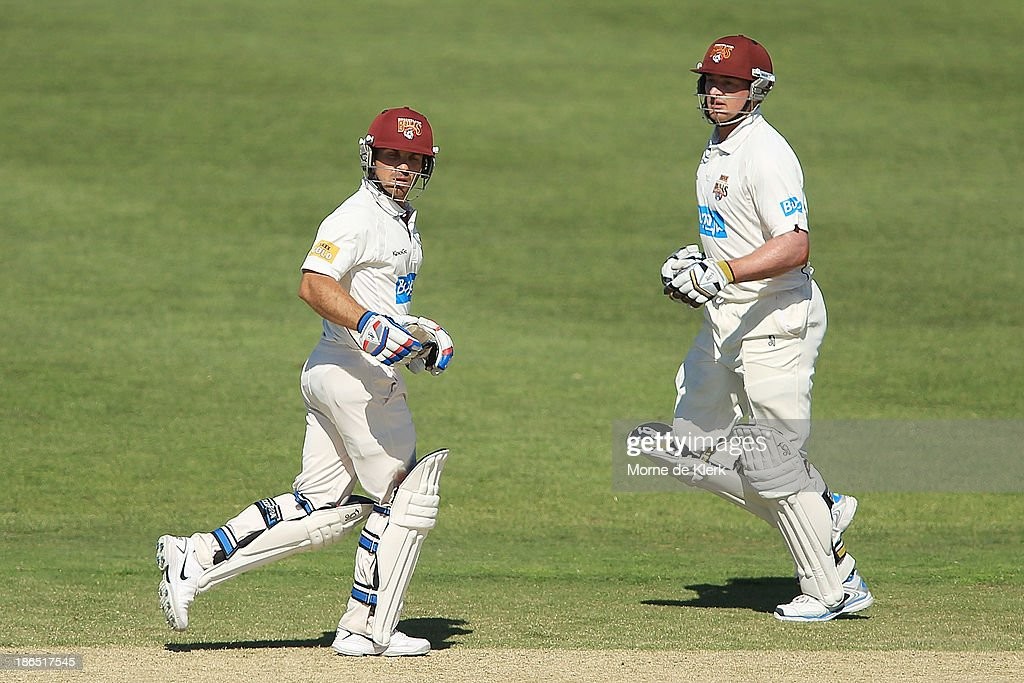 Chris Hartley (L) and Peter Forrest (R) of the Bulls run between the wickets during day three of the Sheffield Shield match between the South Australia Redbacks and the Queensland Bulls at Glenelg Oval on November 1, 2013 in Adelaide, Australia.